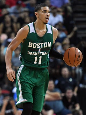 Jayson Tatum dribbles against the Los Angeles Lakers during the second half at Thomas & Mack Arena.
