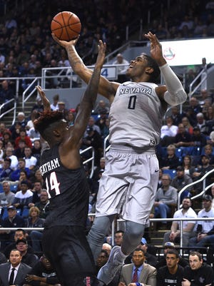 Nevada's Cameron Oliver drives against San Diego State's Zylan Cheatham during their game earlier this season.