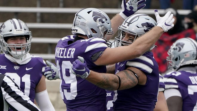 Kansas State tight end Briley Moore, right, celebrates with tight end Samuel Wheeler after scoring a touchdown during the first half against Kansas last Saturday. The Wildcats are the only Big 12 team with a 4-0 record in conference play.
