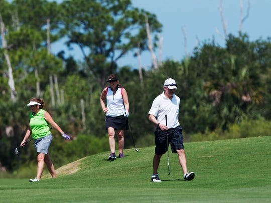 From left, Tammy Janorske, Jeanne and Mike McGinnis play a round of golf at Shadow Wood Country Club Preserve Course in south Fort Myers on Friday 5/22/2015. Shadow Wood is one of several golf course communities in Southwest Florida.