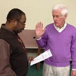 In this Daily Times file photo, Princess Anne Town Commissioner Garland Hayward swears in newcomer to the panel, Dennis Williams.