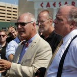 Sen. James Whelan (back center) and Senate President Stephen M. Sweeney (right) listen as Atlantic City Mayor Don Guardian speaks at a 2014 news conference.