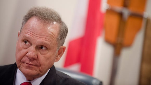 Alabama Chief Justice Roy Moore talks about his order discouraging probate judges from issuing same sex marriage licenses before the Alabama Supreme Court makes a ruling on how the 2015 Supreme Court ruling on Same Sex marriage affects the Alabama Marriage Protection Act on Wednesday, Jan. 6, 2015, at the Alabama Supreme Court building in Montgomery, Ala.