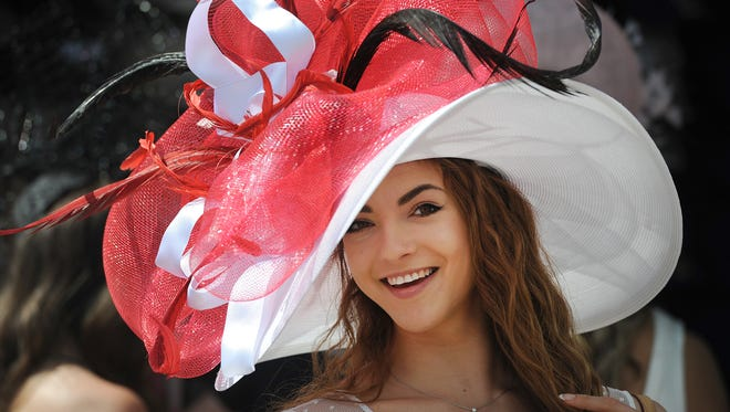 David Hartlage/Special to cj It?s unclear if Milwaukee?s Monique Rosteing?s use of feathery material and University of Louisville colors was intentional. Monique Rosteing of Milwaukee, WI. shows off her Derby hat as she walks around Churchill Downs on race day of the 142nd running of the Kentucky Derby in 2016. David Hartlage/Special to the CJ It's unclear if Milwaukee's Monique Rosteing's use of feathery material and University of Louisville colors was intentional. Monique Rosteing of Milwaukee, WI. shows off her Derby hat as she walks around Churchill Downs on race day of the 143rd running of the Kentucky Derby. May 7, 2016. Photo by David Lee Hartlage, Special to the Courier-Journal.