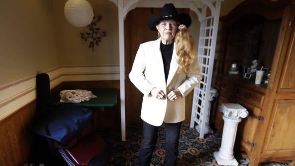 Bonnie Lou Bishop prepares to perform Saturday at a