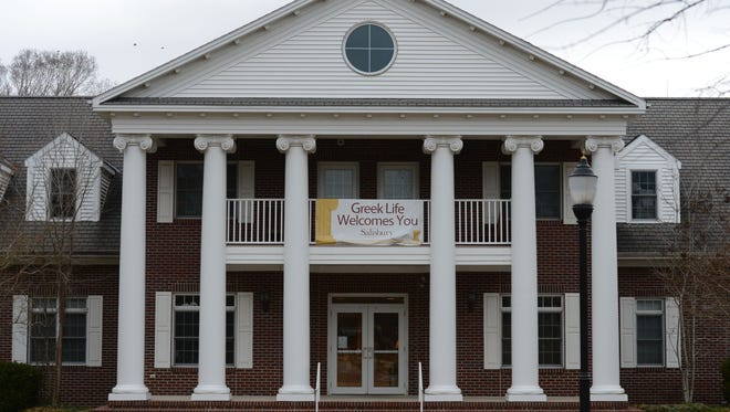 A Greek Life Welcomes you sign on the front of the Scarborough Student Leadership Center at Salisbury University.