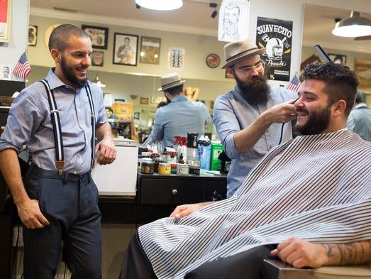 Hazel Vazquez, co-owner of 5th Avenue Barber & Shave