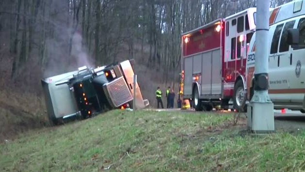 A tractor trailer hauling cattle overturned in the Town of Chenango.