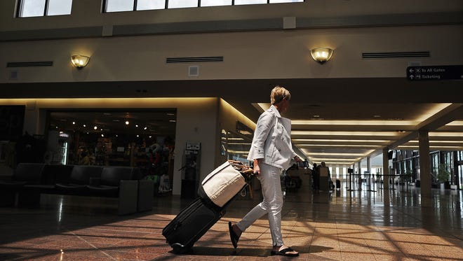 Melissa Anderson of Sioux Falls walks to the exit of the Sioux Falls Regional Airport after arriving from Chicago on June 2.