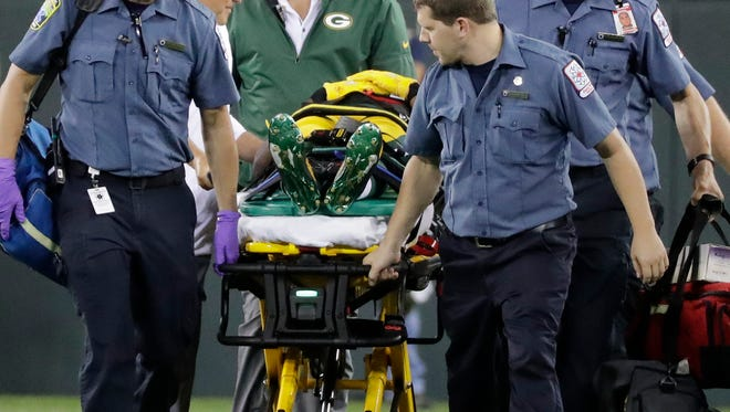 Green Bay Packers wide receiver Malachi Dupre (19) is stretchered off the field in the fourth quarter against the Philadelphia Eagles on Thursday, August 10, 2017, at Lambeau Field.