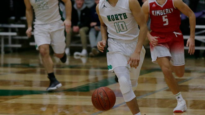 Oshkosh North's Quincy Anderson leads a fast break against Kimberly on Friday.