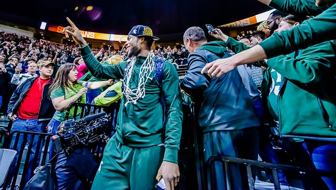 Michigan State's Branden Dawson greets the crowd gathered at the Breslin Center to celebrate the Spartans' Elite Eight win over Louisville Sunday March 29, 2015 in East Lansing.