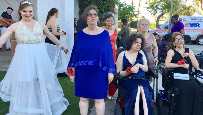Marian James House residents awaiting the arrival of 14 wheelchair-accessible vans before the annual Angel View prom at the Demuth Community Center.