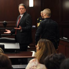 The defendant, Michael Dunn, stands after the verdicts were announced by the jury foreperson and raises his hands in disbelief as he looks at his parents. The trial of Michael Dunn for the shooting death of Jordan Davis in November 2012, covered six days of testimony and concluded on Thursday Feb. 13, 2014.