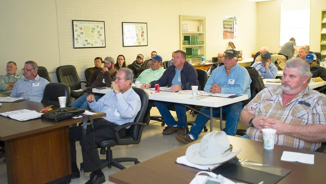 Attendees at a workshop held at the Red River Research Station on Dec. 8-9 listen to presentations about sustainable irrigation practices.