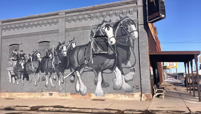 Andrew Fowler and Jim DeStaffany of Conrad painted this mural on Ed's Tavern.