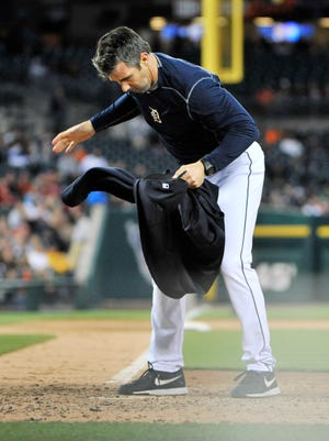 After being ejected, Tigers manager Brad Ausmus  puts his sweatshirt on home plate in the fourth inning.