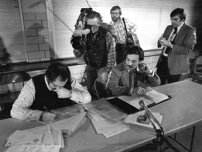 A television crew records tabulation at the Democratic