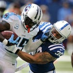 Colts LaRon Landry brings down Tennessee wide receiver Nate Washington in the first half of the game at Lucas Oil Stadium on Sunday, September 28, 2014.