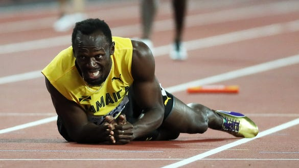 12 devastating photos of Usain Bolt collapsing in his final race