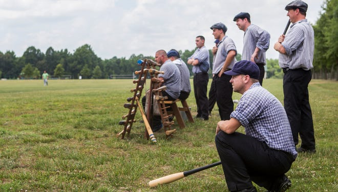 """Diamond State's Frank """"Dutch"""" Brevoort IV kneels on deck as he waits to bat during a game against the Milford Excelsior Base Ball Club at Browns Branch County Park in Harrington, Del. on Sunday."""