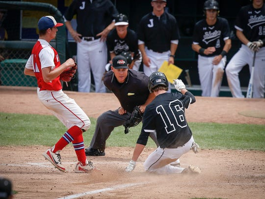 Johnston senior Drew Beazley slides into home plate ahead of the throw against Cedar Rapids Washington in Class 4A action during the Iowa high school boys state baseball tournament on Wednesday, July 25, 2018, in Des Moines.