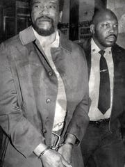 4. Green Haven Correctional Facility inmate Lemuel Smith is led into a courtroom at the Dutchess County Courthouse during his 1983 trial. Smith was convicted of first-degree murder in the strangulation of Corrections Officer Donna Payant. (Journal file photo)