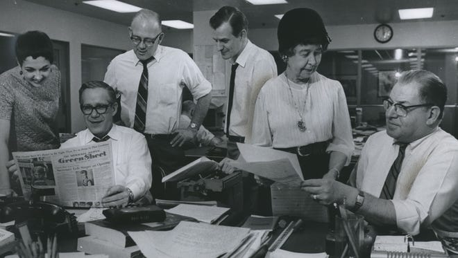 The staff of and contributors to The Milwaukee Journal's Green Sheet look over their handiwork in this May 18, 1969, photo. From left: Margo Huston, youth panel moderator (and 1977 Pulitzer Prize winner); Wade Mosby, Green Sheet and TV Screen Magazine editor; Gerald Kloss, columnist; Dominque Noth, copy editor; Ione Quinby Griggs, columnist, and Bennett Waxse, Green Sheet staff member.