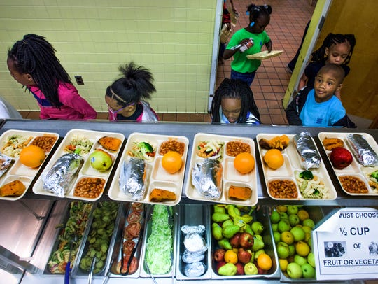Students eat lunch at Brewbaker Primary School in Montgomery,
