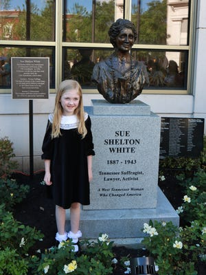 A future voter smiles May 25 at the unveiling of the Sue Shelton White monument at City Hall.