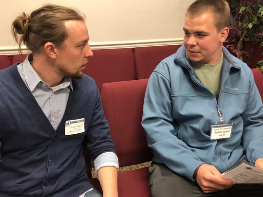 Brett Paul (right), who participated in a reentry simulation