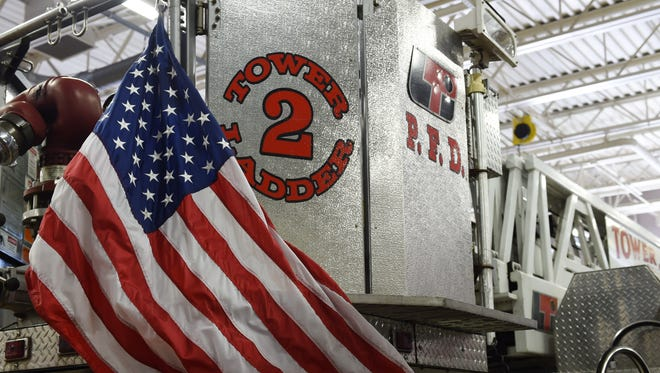 The City of Poughkeepsie Fire Department's tower ladder 2 is displayed with an American flag at the Public Safety Building in this file photo from August 2016.