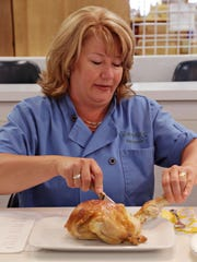 Chef Amy Barnes cuts apart a chicken during our rotisserie chicken challenge in Scottsdale on June 1, 2015.