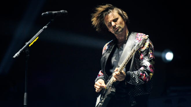 Matt Bellamy of Muse performs during the band's headlining set on day two of the 2014 Coachella Music and Arts Festival.