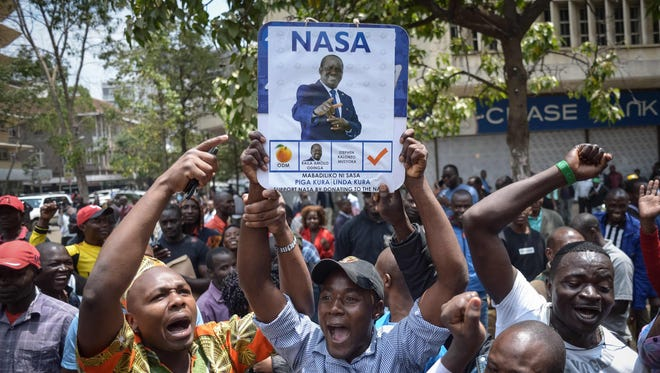 Supporters of Kenya's National Super Alliance (NASA) celebrate after the Supreme Court ordered a re-run of the Aug. 8 presidential poll in Nairobi on Sept. 1, 2017.