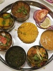 Vegan Thali with Chana Masala, Aloo Jeera, Baingan