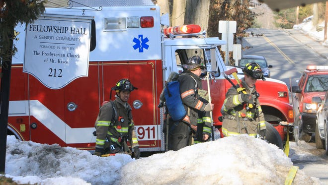 Bedford Hills firefighters work at the scene of a fire that critically injured a person at Fellowship Hall, a senior community on Babbit Road in Bedford Hills Feb. 27, 2014.