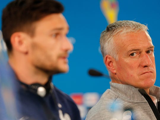 France's Hugo Lloris, left, and head coach Didier Deschamps, right, attend a press conference at the Estadio Beira-Rio in Porto Alegre, Brazil, Saturday, June 14, 2014. France will play in group E of the World Cup. (AP Photo/David Vincent)