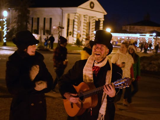 Carol Ambrogio-Wood and Ted Badgerow perform for visitors of Holiday Nights at Greenfield Village.