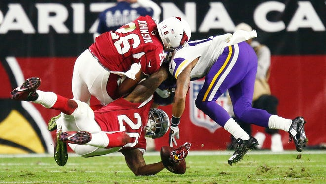 Deone Bucannon (20) recovers the fumble by the Vikings' Jarius Wright (17) in the first half on Dec. 10, 2015 in Glendale, Ariz.