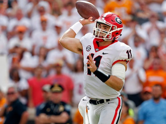 Georgia quarterback Jake Fromm (11) throws to a receiver during the first half of an NCAA college football game against Tennessee Saturday, Sept. 30, 2017, in Knoxville, Tenn. Fromm threw a touchdown pass and ran for two more scores Saturday as No. 7 Georgia rolled to a 41-0 blowout of Tennessee, which suffered its first shutout loss in nearly a quarter-century. (AP Photo/Wade Payne)