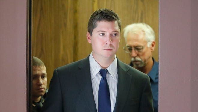 Ray Tensing is pictured arriving at court during jury deliberations in his murder trial, in Cincinnati. Prosecutors in Ohio said a T-shirt with a Confederate flag emblem worn by Tensing, a white police officer, under his uniform was relevant evidence for countering his claim that he feared for his life when he shot Sam DuBose, an unarmed black motorist.