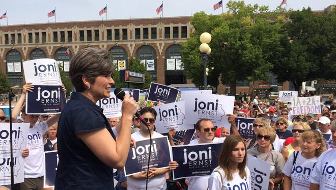 U.S. Senate candidate Joni Ernst on stage at the Des Moines Register's Political Soapbox at the Iowa State Fair.