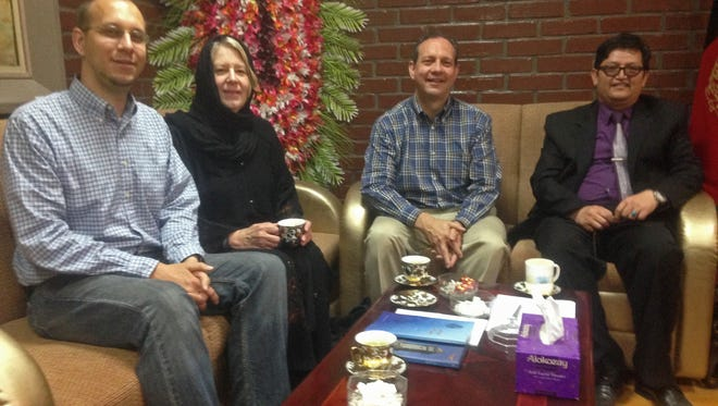 Prior to the attack (from left), John Gabel, his mother, his father Gary Gabel, Mohammad Hadi Hadayati, Kabul University's vice chancellor at Kabul University, in Kabul, Afghanistan.