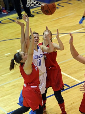Highlands G Lydia Graves puts up a shot in traffic in the girl's basketball game between Highlands and Holmes High School January 29, 2015 at Highlands.