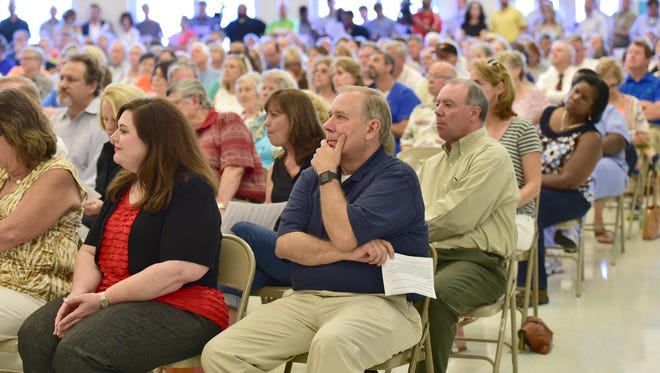 A large crowd packs Ridgeland High School one evening in August to listen to Ridgeland officials discuss the possibility of Costco coming to a phase III expansion of the Renaissance.