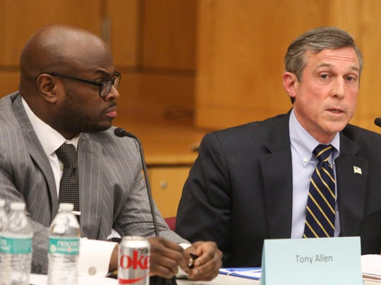 Wilmington Education Improvement Commission Chairman Tony Allen listens to Gov. John Carney during a meeting of the group Tuesday at the Sharp Conference Center.