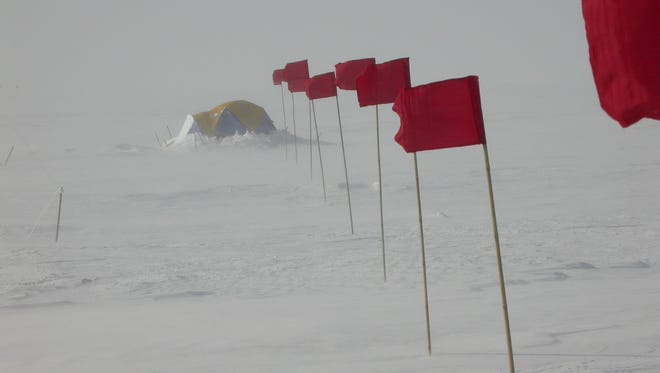 Snow blows at a campsite near Vostok Station during the Antarctic summer.