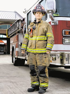 Ginny Cranor is pictured in a News Journal file photo from March 2013, shortly after she and Annie Bloxson became the first women promoted to the rank of fire captain in the Pensacola Fire Department's history.