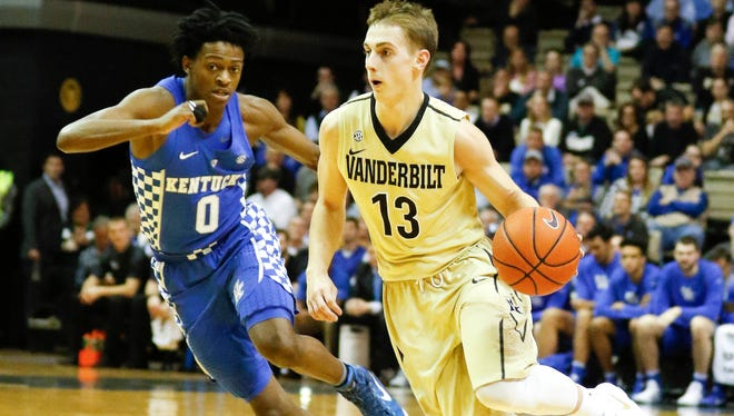 Vanderbilt Commodores guard Riley LaChance (13) dribbles the ball against Kentucky Wildcats guard De'Aaron Fox (0) in the second half at Memorial Gymnasium on Jan. 10.